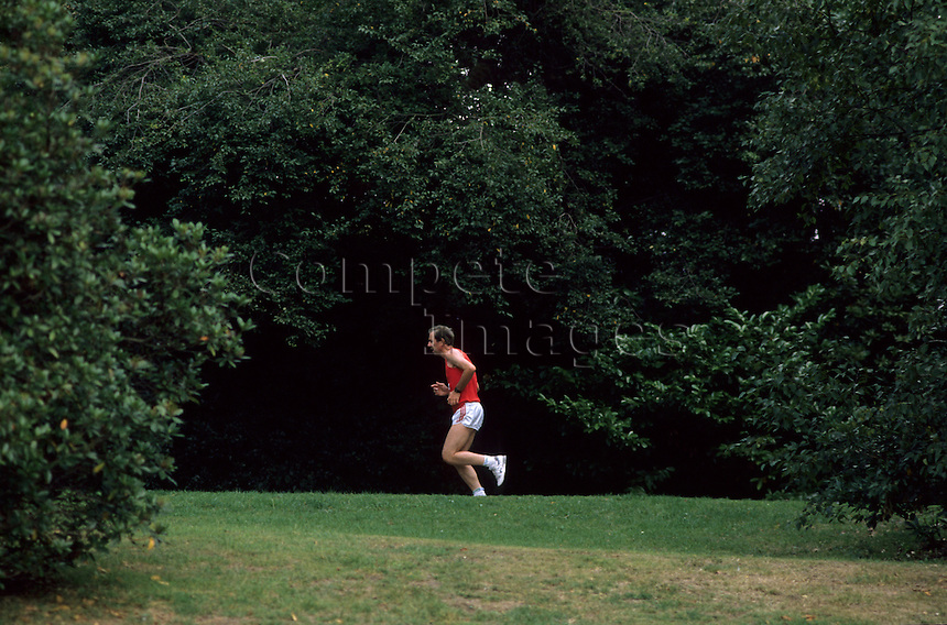 Man jogging through a wooded area