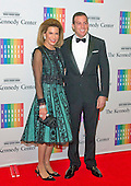 Nancy G. Brinker and Howard Bernick arrive for the formal Artist's Dinner honoring the recipients of the 2013 Kennedy Center Honors hosted by United States Secretary of State John F. Kerry at the U.S. Department of State in Washington, D.C. on Saturday, December 7, 2013. The 2013 honorees are: opera singer Martina Arroyo; pianist,  keyboardist, bandleader and composer Herbie Hancock; pianist, singer and songwriter Billy Joel; actress Shirley MacLaine; and musician and songwriter Carlos Santana.<br /> Credit: Ron Sachs / CNP