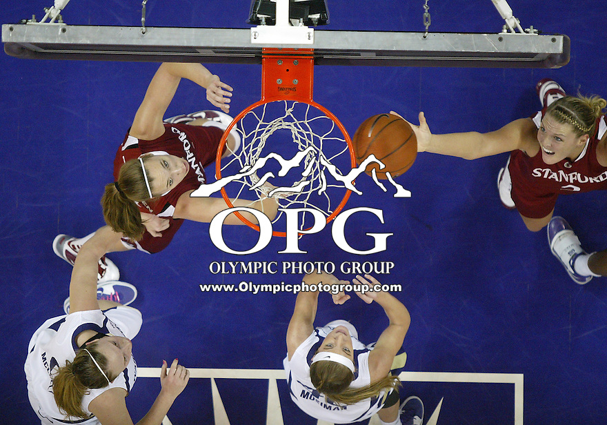 12 February 2010:  Stanford center Jayne Appel pulls down a rebound in front of Washington's #42 Sara Mosiman . Stanford won 58-36 over Washington at the Bank of America Arena in Seattle, WA.