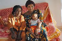 """- a small community of Tuareg, the legendary """"blue men"""" of Sahara, coming from, Niger has settled in Pordenone, town of Italian northeast, being able to achieve a good degree of integration although in the respect of their traditional culture; Assalo, wife of Haddo Oubana El Hadji with last born son and Tima daughter....- una piccola comunità di Tuareg, i leggendari """"uomini blu"""" del Sahara, provenienti dal Niger, si sono stabiliti a Pordenone, città del nord-est italiano, riuscendo a conseguire un buon grado di integrazione pur nel rispetto della loro cultura tradizionale; Assalo, moglie di Haddo Oubana El Hadji col figlio ultimo nato e la figlia Tima"""
