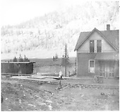 Vance Junction agent's house with RGS 4% grade to Telluride in background.<br /> RGS  Vance Junction, CO  Taken by Joyce, W. D. - 1915
