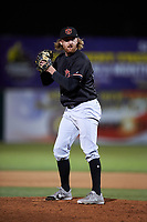 Visalia Rawhide relief pitcher Austin Mason (25) prepares to deliver a pitch during a California League game against the Lancaster JetHawks at The Hangar on May 17, 2018 in Lancaster, California. Lancaster defeated Visalia 11-9. (Zachary Lucy/Four Seam Images)