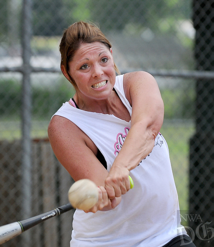 STAFF PHOTO BEN GOFF  @NWABenGoff -- 06/22/14 Summer Ranalli of Tontitown slugs a softball while taking batting practice with other members of her Fayetteville Parks and Recreation women's summer league team at Lake Fayetteville Park on Sunday June 22, 2014.