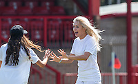 Chloe Page (X-Factor 2015) (right) during the 'Greatest Show on Turf' Celebrity Event - Once in a Blue Moon Events at the London Borough of Barking and Dagenham Stadium, London, England on 8 May 2016. Photo by Andy Rowland.