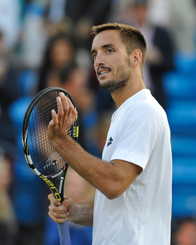 Viktor Troicki (SRB) celebrates his victory over John Isner (USA) in their Men&rsquo;s Singles Quarter Final match - Viktor Troicki (SRB) def John Isner (USA) 7-6, 6-3<br /> <br /> Photographer Ashley Western/CameraSport<br /> <br /> Tennis - ATP 500 World Tour - AEGON Championships- Day 5 - Friday 19th June 2015 - Queen's Club - London <br /> <br /> &copy; CameraSport - 43 Linden Ave. Countesthorpe. Leicester. England. LE8 5PG - Tel: +44 (0) 116 277 4147 - admin@camerasport.com - www.camerasport.com