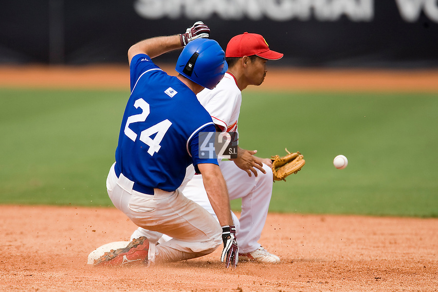 18 August 2007: Left Field #24 Gaspard Fessy slides toward second base during the China 5-1 victory over France in the Good Luck Beijing International baseball tournament (olympic test event) at the Wukesong Baseball Field in Beijing, China.