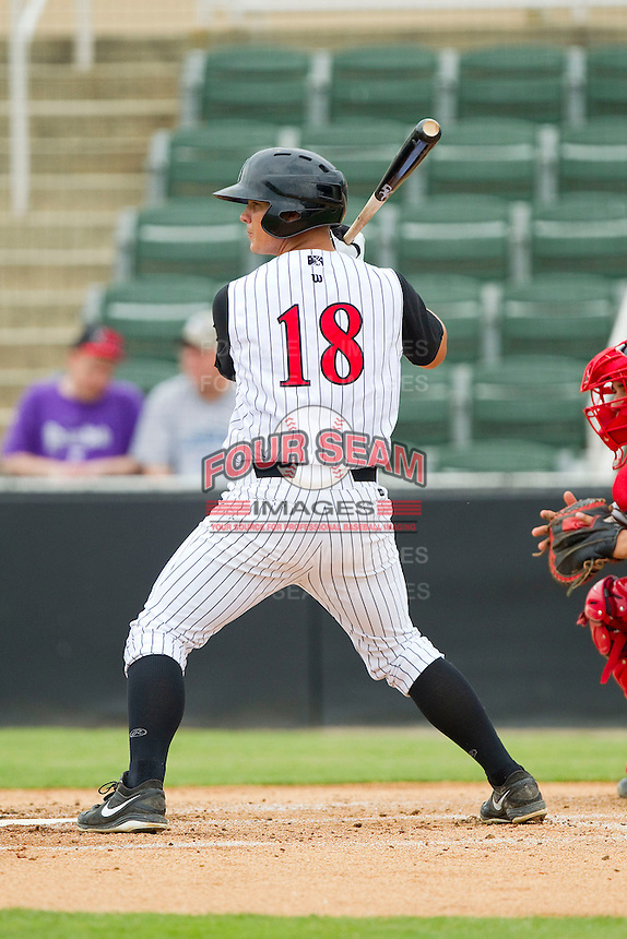 Eric Grabe (18) of the Kannapolis Intimidators at bat against the Greenville Drive at CMC-Northeast Stadium on June 30, 2013 in Kannapolis, North Carolina.  The Drive defeated the Intimidators 3-0.   (Brian Westerholt/Four Seam Images)