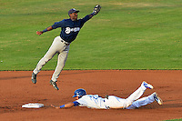 Helena Brewers second baseman Renaldo Jenkins (2) leaps to catch the throw as Alex Santana (21) of the Ogden Raptors slides to the bag at Lindquist Field on July 23, 2013 in Ogden Utah. (Stephen Smith/Four Seam Images)
