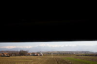 ROMANIA / Transylvania / Between Brasov and Sibiu / 08.03.2007 / A view of the Fagaras mountain range from a train in. © Davin Ellicson / Anzenberger