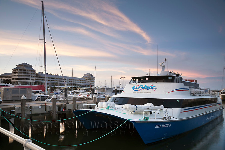 Dive boat at Marlin Marina with Shangri-La Hotel in background.  Cairns, Queensland, Australia