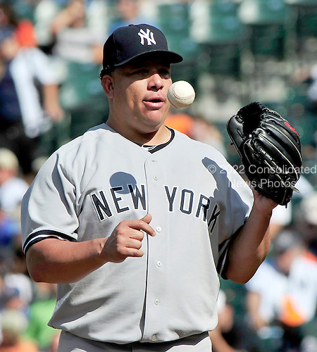 New York Yankees pitcher Bartolo Colon (40) flips the ball into his glove in the eighth inning against the Baltimore Orioles at Oriole Park at Camden Yards in Baltimore, Maryland in the first game of a doubleheader on Sunday, August 28, 2011.  The Orioles won the game 2 - 0..Credit: Ron Sachs / CNP.(RESTRICTION: NO New York or New Jersey Newspapers or newspapers within a 75 mile radius of New York City)