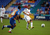 Pictured: Andrea Orlandi of Swansea (R) crossing the ball forward. Tuesday 23 August 2011<br />