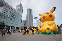 People enjoy looking at inflatable Pikachu characters outside Sakuragicho station during the third annual Pikachu Outbreak event in Yokohama, Kanagawa, Japan. Wednesday August 10th 2016. The event is hosted by the Pokemon Company. Over 1,000 Pikachu characters are set to appear in week of events from 7th to 14th of August..