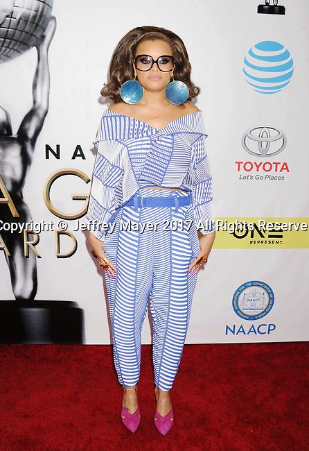 PASADENA, CA - FEBRUARY 11: Singer-songwriter Andra Day arrives at the 48th NAACP Image Awards at Pasadena Civic Auditorium on February 11, 2017 in Pasadena, California.