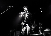 The Stranglers - guitarist Hugh Cornwell - performing live performing live on the first of five sold out shows at the Roundhouse in London UK - 02 Nov 1977.  Photo credit: George Bodnar Archive/IconicPix