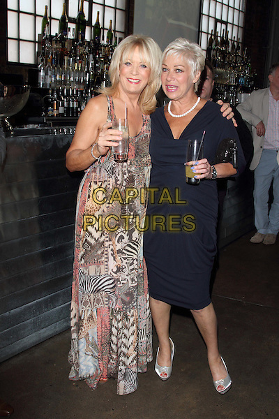 Denise Welch and Sherrie Hewson.Welch Morgan Locations launch party at The Collection, Brompton Road, London, England.June 28th 2012.full length blue dress pink black blue beige leopard zebra animal print drink beverage .CAP/ROS.©Steve Ross/Capital Pictures.