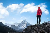 A trekker in front of Ama Dablam, Khumbu Valley, Nepal