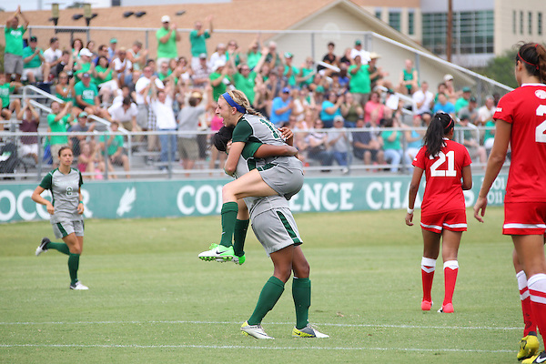 Denton, TX - AUGUST 31:  Michelle Young #16 of the North Texas Mean Green soccer celebrates scoring a goal  with Karla Pineda #9 against University of Houston Cougars at the Mean Green Village Soccer Field on August 31, 2012 in Denton, Texas. NT won 2-1.(Photo by Rick Yeatts)