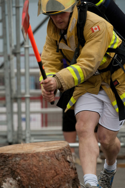 Vancouver, Canada, Aug 6th 2009.  World Police and Fire Games, Ultimate Firefighter Competition. Competitor Valdimar Gunnarsson from the Reykjavik Fire Department, Iceland, sets the axe into the log during the Weight and Strength Stage of the competition.  Photo by Gus Curtis