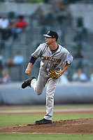 Starting pitcher Janson Junk (16) of the Charleston RiverDogs delivers a pitch during a game against the Columbia Fireflies on Wednesday, August 29, 2018, at Spirit Communications Park in Columbia, South Carolina. Charleston won, 6-1. (Tom Priddy/Four Seam Images)