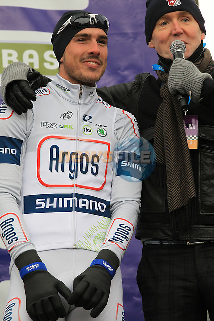 John Degenkolb (GER) Team Argos-Shimano being interviewed on the podium with temperatures at -3 and wind chill of -16 at the sign on before the 75th edition of Gent-Wevelgem in Deinze, Belgium, 24th  March 2013 (Photo by Eoin Clarke 2013)