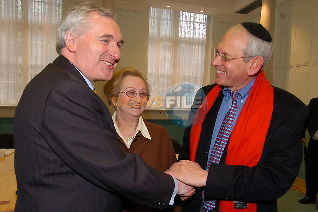 Left The (Taoiseach) Prime Minister and President of the European Council, Mr Bertie Ahern welcomes Israel Singer Chairman of Governing board of the World Jewish Council to Dublin During the Presidency of the EU watched by Mrs. Estelle Menton President of the Jewish Representative Council of Ireland. Dublin, Ireland 22th january 2004.Photo AFP/Newsfile/Fran Caffrey..This Picture has been sent to you by Newsfile Ltd..The Studio,.Millmount Abbey,.Drogheda,.Co. Meath,.Ireland..Tel: +353(0)41-9871240.Fax: +353(0)41-9871260.ISDN: +353(0)41-9871010.www.newsfile.ie..general email: pictures@newsfile.ie