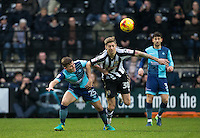 Dominic Gape of Wycombe Wanderers battles Jonathan Stead of Notts Co during the Sky Bet League 2 match between Notts County and Wycombe Wanderers at Meadow Lane, Nottingham, England on 10 December 2016. Photo by Andy Rowland.