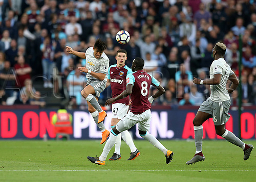 10th May 2018, London Stadium, London, England; EPL Premier League football, West Ham United versus Manchester United; Alexis Sanchez of Manchester United heads the ball to Paul Pogba of Manchester United over Cheikhou Kouyate of West Ham United