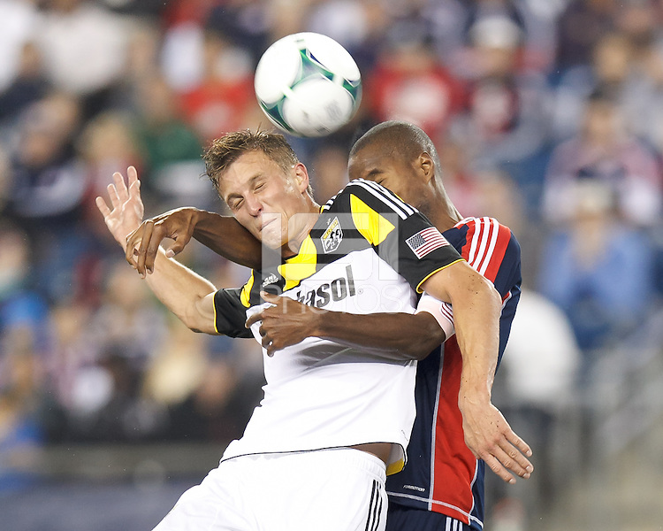 Columbus Crew substitute forward Aaron Schoenfeld (18) and New England Revolution defender Jose Goncalves (23) battle for head ball.  In a Major League Soccer (MLS) match, the New England Revolution (blue) defeated Columbus Crew (white), 3-2, at Gillette Stadium on October 19, 2013.