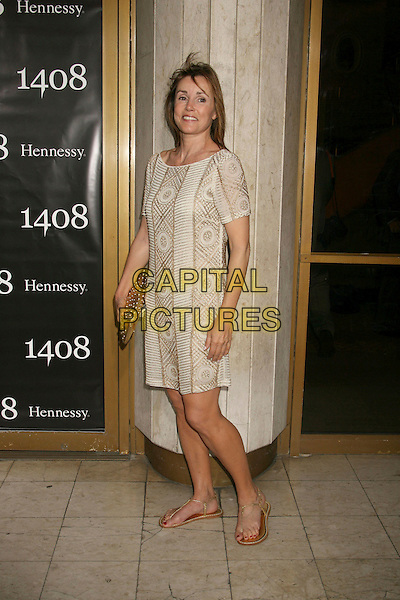 """ALEX DONNELLEY.""""1408"""" World Premiere held at the Mann National Theater, Westwood, California, USA..June 12th, 2007.full length beige gold print dress flip flops sandals clutch purse .CAP/ADM/RE.©Russ Elliot/AdMedia/Capital Pictures"""