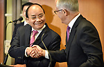 Prime Minister of the Socialist Republic of Vietnam Nguyen Xuan Phuc (L) and Australian Prime Minister Malcolm Turnbull (R) shake hands after a signing ceremony at Parliament House, Canberra, Thursday, March 15, 2018. Mr Nguyen Xuan Phuc is on a four-day official visit to Australia. AFP PHOTO/ MARK GRAHAM