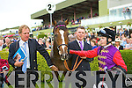 Her Majesty the Queen's horse Four Winds with jockey Jamie Spencer, trainer Michael Bell and handler Matthew Morgan in the parade ring after been beaten by Aidan O'Brien's horse Poet in the Vincent O'Brien Ruby stakes at the Killarney Races on Tuesday.