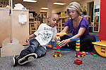 September 14, 2011. Raleigh, NC. . Kim Jackson, the head teacher for the class, works with Zaire Hines.. Project Enlightenment, a public pre-kindergarten program for at risk children, has been threatened with closure due to state wide budget cuts..