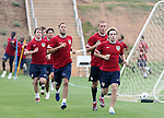 Bobby Convey (r) leads (from right) Jimmy Conrad, Clint Dempsey, Brian Ching, and non-roster practice player Michael Bradley during a timed run on Thursday, May 11th, 2006 at SAS Soccer Park in Cary, North Carolina. The United States Men's National Soccer Team held a training session as part of their preparations for the upcoming 2006 FIFA World Cup Finals being held in Germany.