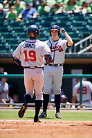 Mississippi Braves designated hitter Jared James (19) is congratulated by Reed Harper (17) as he crosses home plate after hitting a home run in the top of the eighth inning during a game against the Montgomery Biscuits on April 25, 2017 at Montgomery Riverwalk Stadium in Montgomery, Alabama.  Mississippi defeated Montgomery 3-2.  (Mike Janes/Four Seam Images)