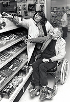 Carer & elderly man shopping UK 1992