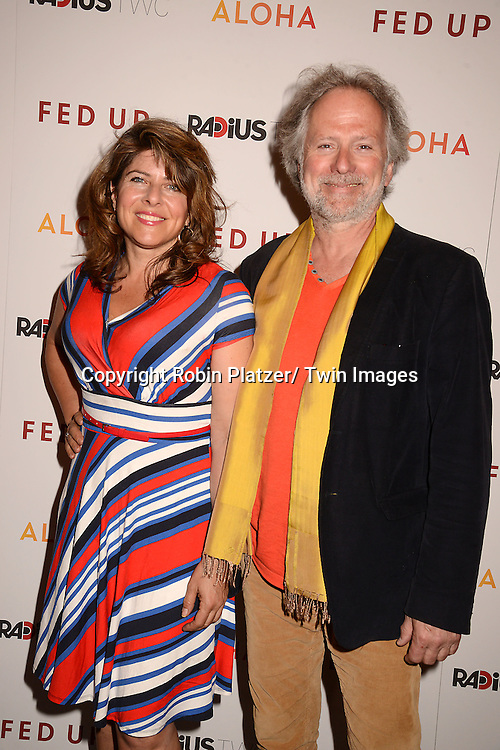 """Naomi Wolfe and David Hykes attends the New York Premiere of """"FED UP"""" on May 6, 2014 at The Museum of Modern Art in New York City."""