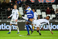 Bright Osayi-Samuel of Queens Park Rangers under pressure from Rhian Brewster of Swansea City during the Sky Bet Championship match between Swansea City and Queens Park Ranger at the Liberty Stadium in Swansea, Wales, UK. Tuesday 11 February 2020