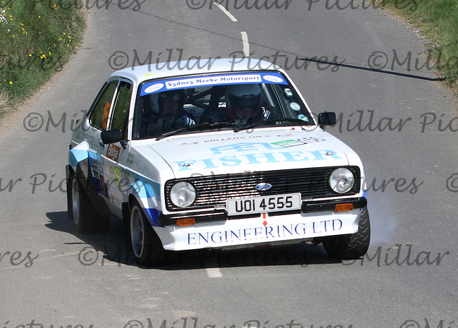 Philip Wylie - John Young in a Ford Escort near Junction 4 on Special Stage 1 Loughries Village of the Discover Northern Ireland Circuit of Ireland Rally which was a constituent round of  the FIA European Rally Championship, the FIA Junior European Rally Championship, the Clonakilty Irish Tarmac Rally Championship, and the MSA ANICC Northern Ireland Stage Rally Championships which took place on 18.4.14 and 19.4.14 and was based in Belfast.