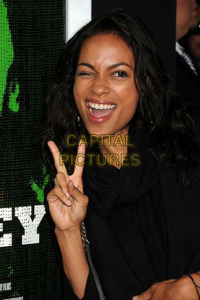 """Rosario Dawson.""""Marley"""" Los Angeles Premiere held at Arclight Cinemas, Hollywood, California, USA..April 17th, 2012.headshot portrait black hand v peace sign mouth open wink winking eye closed.CAP/ADM/BP.©Byron Purvis/AdMedia/Capital Pictures."""