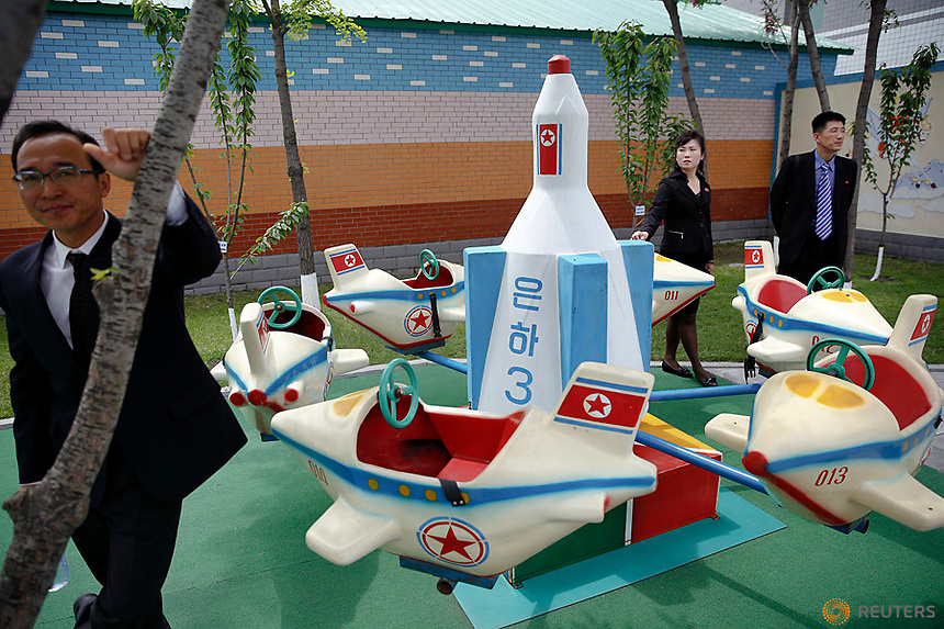 PLEASE TPX THIS PICTURE<br /> <br /> Officials accompanying foreign reporters stand near a rocked themed marry-go-around at kindergarden of a factory reporters visit on a government organised tour in central Pyongyang, North Korea May 9, 2016.  REUTERS/Damir Sagolj