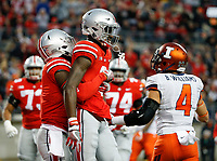 Ohio State Buckeyes wide receiver Johnnie Dixon, left, congratulates teammate Ohio State Buckeyes wide receiver Binjimen Victor (9) after Victor scored a touchdown during the first quarter of a NCAA college football game between the Ohio State Buckeyes and the Illinois Fighting Illini on Saturday, November 18, 2017 at Ohio Stadium in Columbus, Ohio. [Joshua A. Bickel/Dispatch]