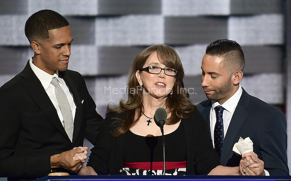 Christine Leinonen, mother of Christopher &quot;Drew&quot; Leinonen, one of the 49 victim s of the &quot;Pulse&quot; attack in Orlando, Florida, flanked by Brandon Wolf and Jose Arraigada, who are survivors of that attack, makes remarks during the third session of the 2016 Democratic National Convention at the Wells Fargo Center in Philadelphia, Pennsylvania on Wednesday, July 27, 2016.<br /> Credit: Ron Sachs / CNP/MediaPunch<br /> (RESTRICTION: NO New York or New Jersey Newspapers or newspapers within a 75 mile radius of New York City)