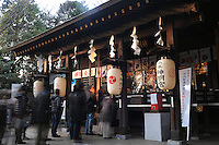 A shrine in a residential area in Tokyo, Japan.  The Japanese celebrate the first three days of the New Year which are public holidays and days of rest of visits to shrines and temples.
