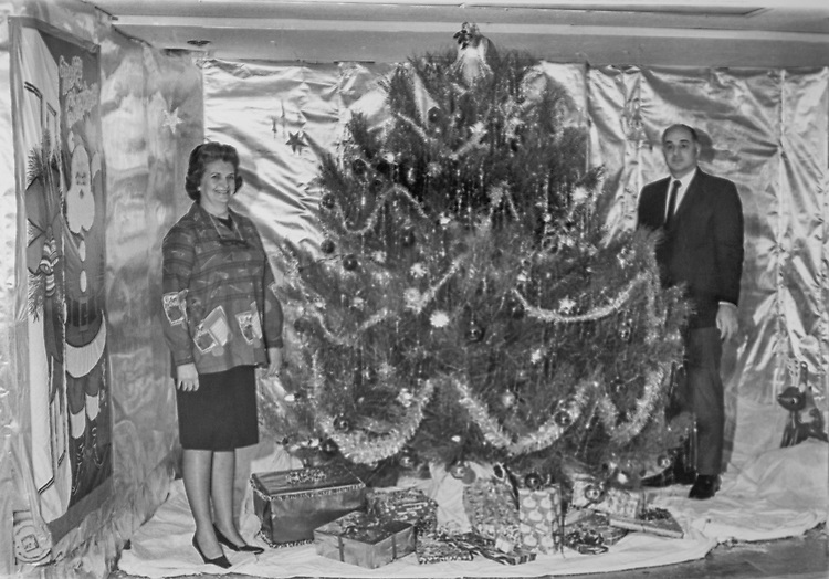 Congressman and his wife standing besides Christmas tree in his office during Christmas. (Photo by CQ Roll Call via Getty Images)