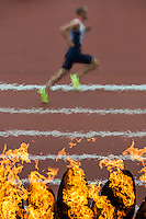 03.08.2012 Stratford, England. Great Britains Dai Green (GBR) runs past the Olympic flame on the way to winning his Mens 400m Hurdles heat on day 7 of the London 2012 Olympic Games in the Olympic Stadium on the Olympic Park.
