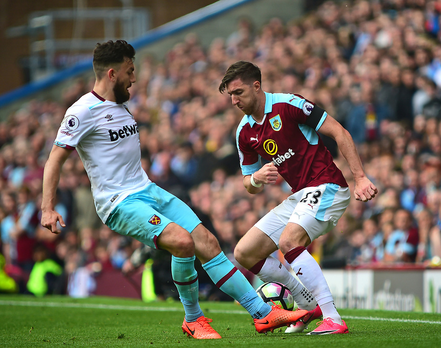 West Ham United's Robert Snodgrass vies for possession with Burnley's Stephen Ward<br /> <br /> Photographer Andrew Vaughan/CameraSport<br /> <br /> The Premier League - Burnley v West Ham United - Sunday 21st May 2017 - Turf Moor - Burnley<br /> <br /> World Copyright &copy; 2017 CameraSport. All rights reserved. 43 Linden Ave. Countesthorpe. Leicester. England. LE8 5PG - Tel: +44 (0) 116 277 4147 - admin@camerasport.com - www.camerasport.com