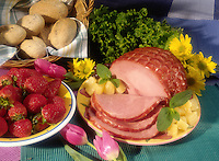 Baked ham, rolls and strawberries.