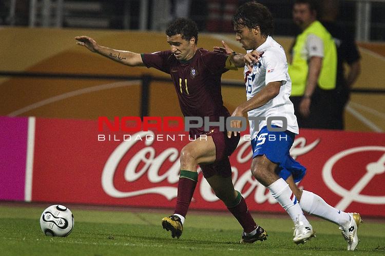 FIFA WM 2006 -  Round of Sixteen - / Viertelfinale <br /> Play    #52 (25-Jun) - Netherland - Portugal.<br /> Sabrosa Simao und Giovanni van Bronckhorst.<br /> <br /> Foto &copy; nordphoto