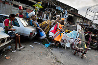 A Brazilian man watches discarded carnival statues abandoned on the work yard behind the Samba school workshops in Rio de Janeiro, Brazil, 15 February 2012. Most of the large carnival floats, colorful designs and fancy costumes are dismantled, cut into pieces or simply thrown into garbage right after the last day of the Carnival. The low-tech materials as fiberglass, plastic or polystyrene, which most of the of the carnival floats and statues are made of, are stocked in the warehouses to be recycled and used in the future parades. However, there is no use for some of the statues so they slowly fall apart into pieces forming a ?Carnival cemetery? in the industrial yards around the port of Rio de Janeiro.